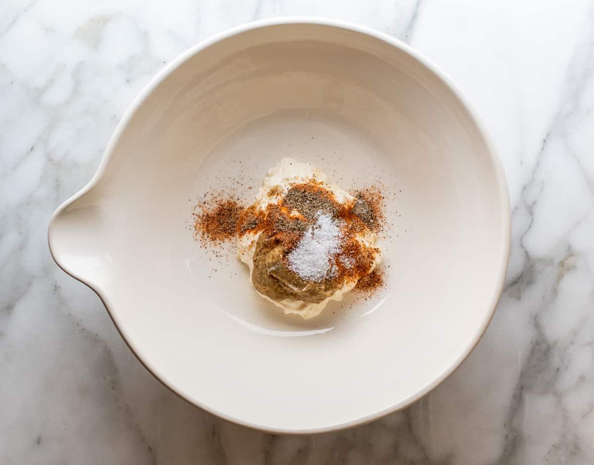 dressing ingredients in bottom of large mixing bowl