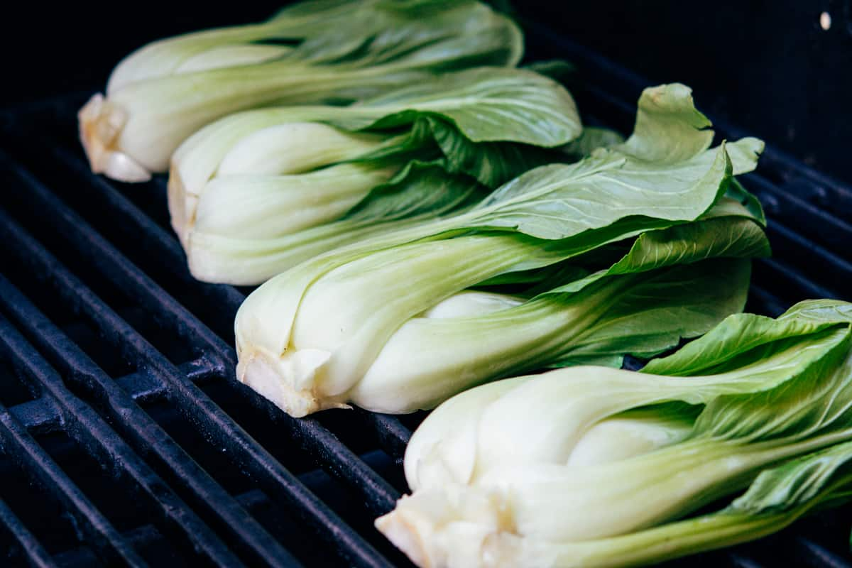 halved heads of Baby Bok Choy halved on the grill