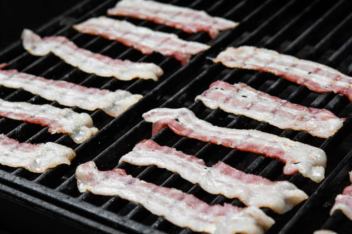 partially cooking bacon on the grill