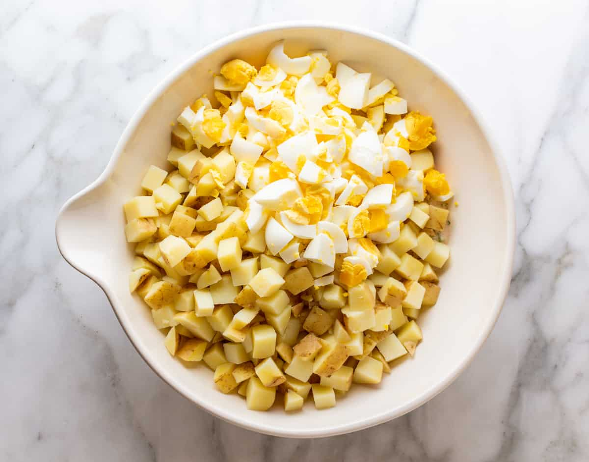 potatoes and chopped hard boiled eggs added to mixing bowl