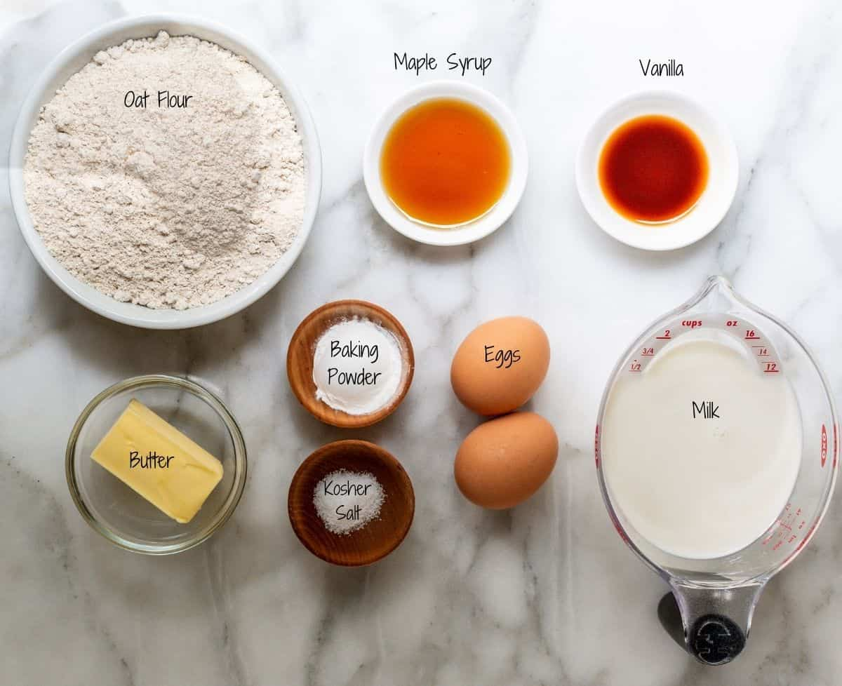 Oat Flour Pancakes Ingredients on a white marble board.