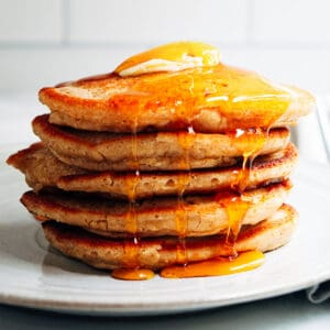 oat flour pancakes with butter and maple syrup.