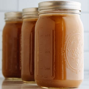 Homemade Pork Bone Broth in glass quart canning jars.