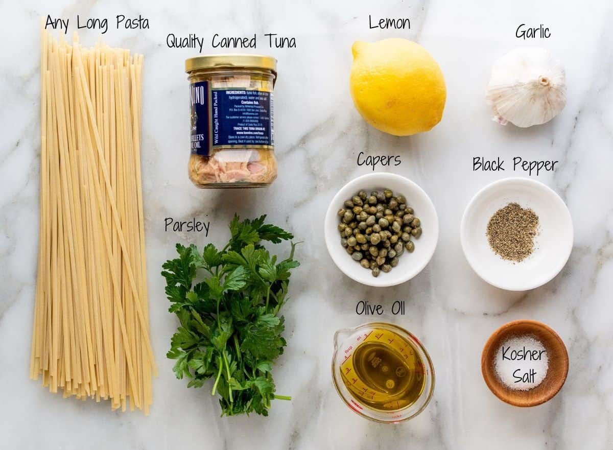 Tuna Pasta Ingredients on a white marble board.