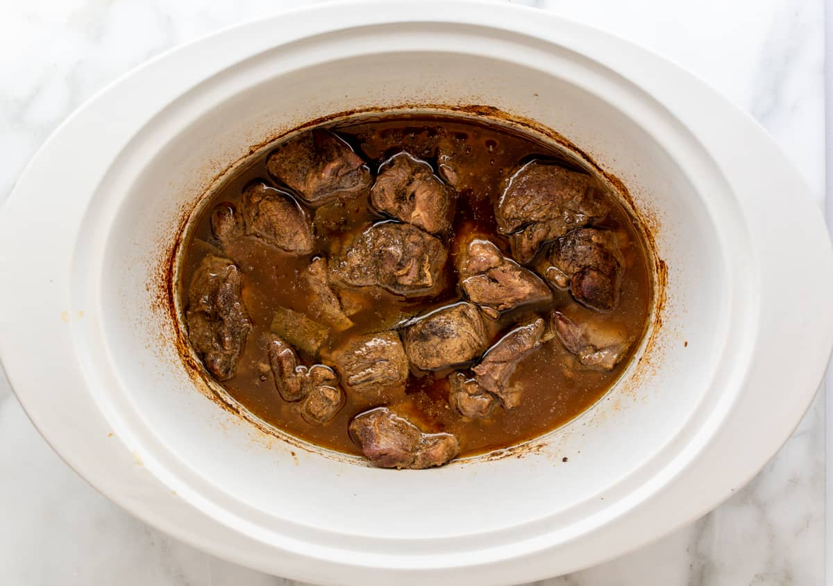 cooked lamb barbacoa in slow cooker.