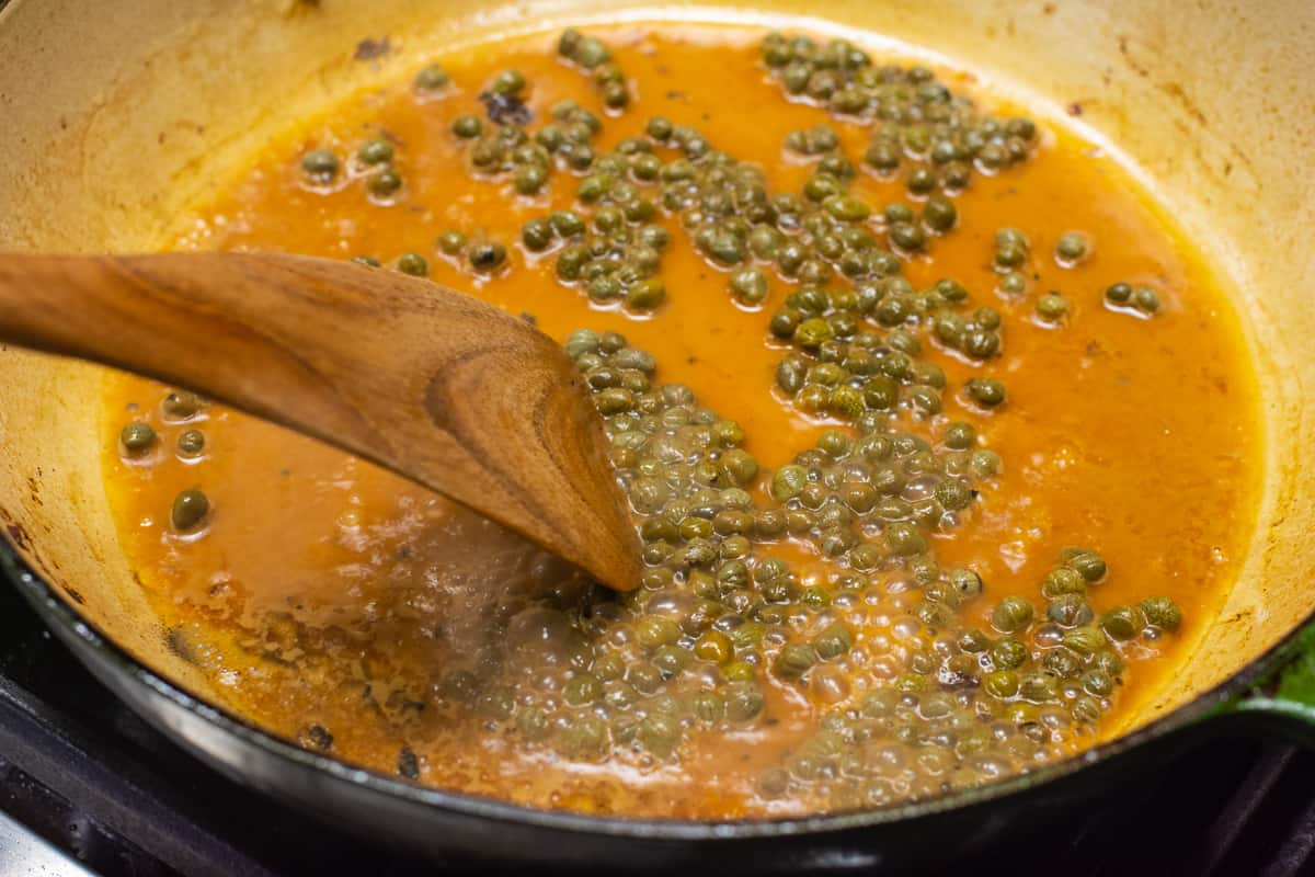 making piccata sauce in a skillet.